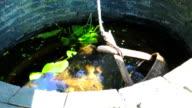 bucket dip into water well