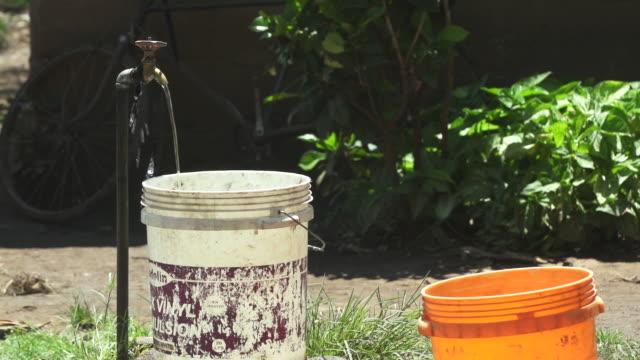 Buckets By Outdoor Ground Water Spigot