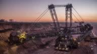 Bucket-Wheel excavator in open-cast coal mine in Germany at dusk