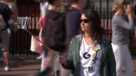 Police reveal suspect had a fourfoot sword Buckingham Palace Tourists along past gates Woman with selfie stick Mounted police along