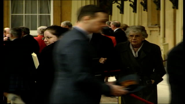 recipients chatting to press ENGLAND London Buckingham Palace EXT Jim Davidson along wearing kilt / Davidson poses for press holding award / people...