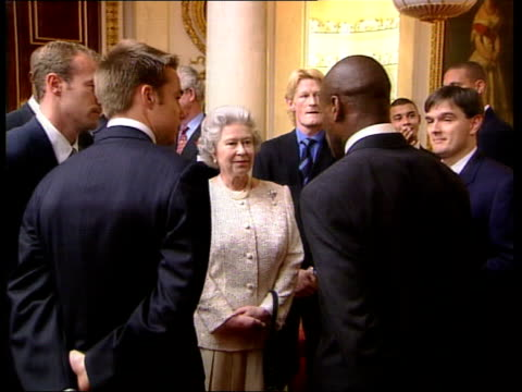 Buckingham Palace World Cup reception BBC Buckingham Palace Queen greeting British footballers who took part in 1998 World Cup at reception CMS Queen...