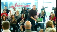 Milton Keynes INT David Cameron MP wearing casual clothes with shirt unbuttoned and sleeves rolled up into room full of applauding young voters and...