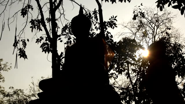 Buddha statue on sunset