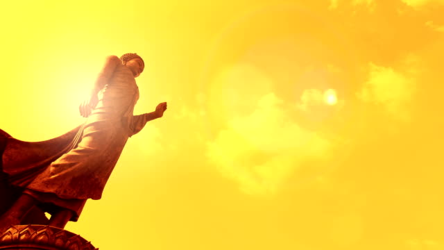 Buddha Time lapse con sole flare