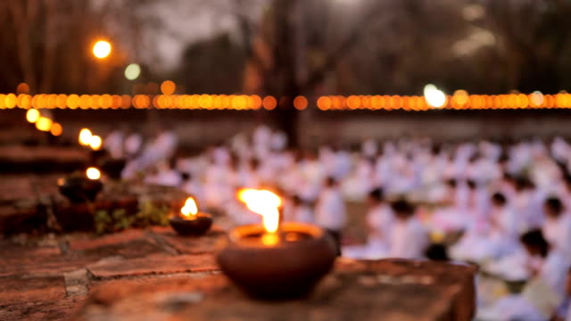 Buddhism lighted candles trail around ancient temple