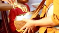 Buddhist Monk receive food