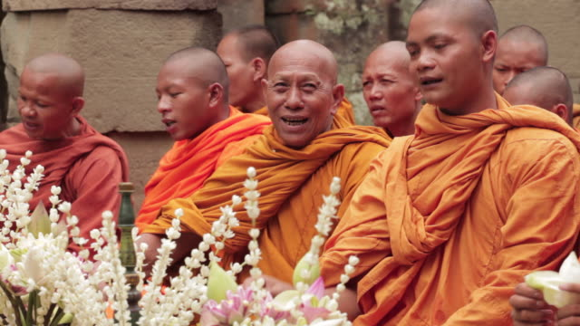 Buddhist monks take part in a ceremony at the Angkor Wat Temple, Cambodia.