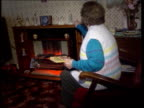 VAT on fuel OAPs call for compensation INT SEQ Old lady and electric fire ITN