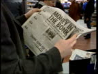 Election prediction ITN ENGLAND London INT People in newsagents standing around reading newspapers Newspapers on display ZOOM IN front page of 'The...