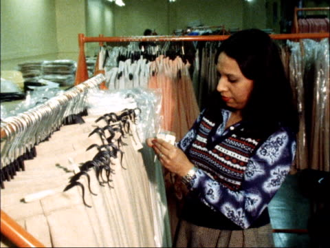 shops react to 15 per cent VAT rise ENGLAND London INT MS Selfridges department store price tags passing through printing machine Woman worker at...
