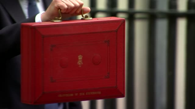 What do Hammond's constiuents want to hear from the Chancellor R080317009 / 832017 Downing Street Hammond posing for photocall with budget box and...
