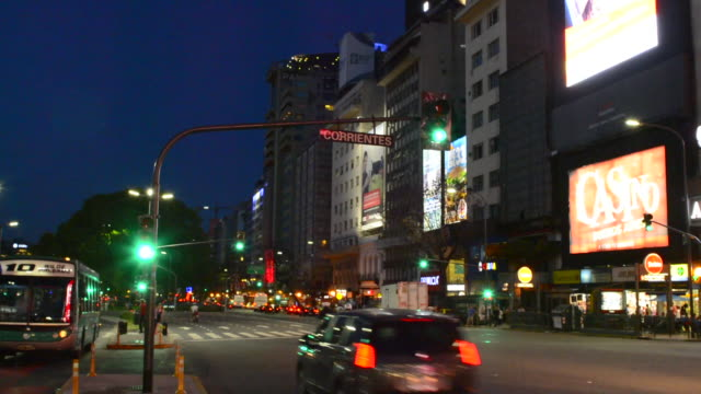 Buenos Aires Argentina 9 de Julio Avenue the widest street in the world with traffic at night twilight at Corrientes Street blurs of car lights