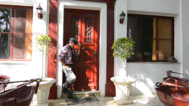 Buenos Aires Argentina Gaucho cowboy at ranch Don Silvano Ranch with cowboy clothes at door model released MR and MR-3