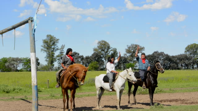 Buenos Aires Argentina Gaucho cowboy ranch for tourists outside city called Don Silvano Ranch with horses and gauchos on horses