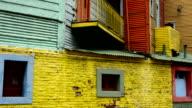 Buenos Aires Argentina La Boca colorful bright primary colors worn walls and windows