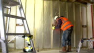 Builder installs Insulation in walls of new house