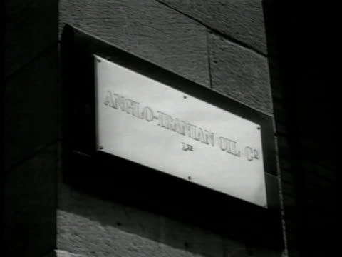 AIOC building 'AngloIranian Oil Co' sign HA XWS TB Sanitarium of Shiraz building in mountains Male doctor talking w/ female patient on porch holding...
