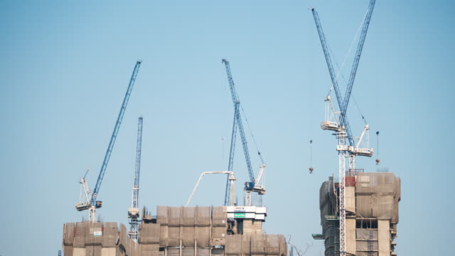 Building Construction Site With Many Cranes Working
