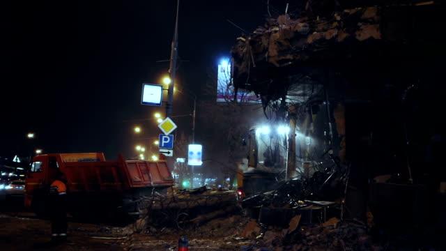 Building demolition at night