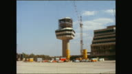 Building place of the new airport 'Otto Lilienthal' Tegel parking place in front of the main building with many cars airplane of the airline 'Modern...