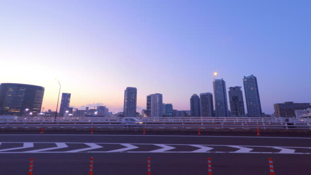 Buildings and bridge at dusk -4K-