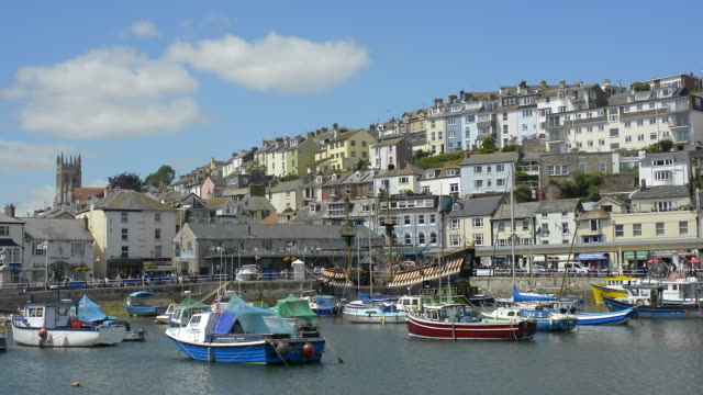 Buildings in the town of Brixham rise up above the fishing boats in the harbour