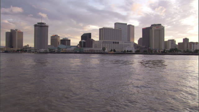 Buildings of downtown New Orleans provide a changing scene for a passing boat.