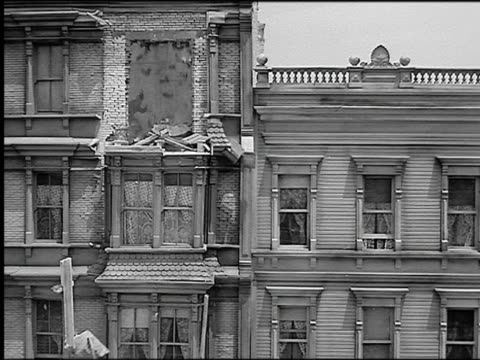 B/W 1906 REENACTMENT buildings shaking + falling apart in earthquake / couple panic in room of building (model)