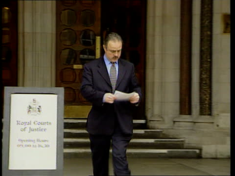 court decision on anonymity ITN ENGLAND London High Court EXT Norman Brennan along from doorway to press conference Norman Brennan press conference...