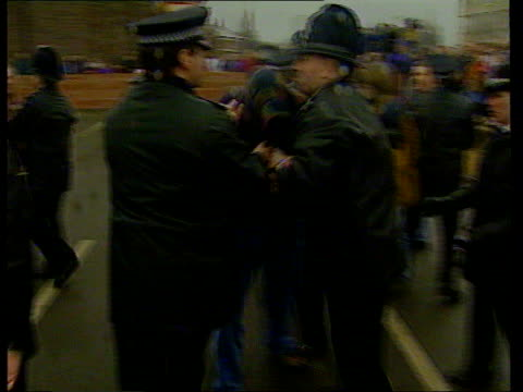 court decision on anonymity LIB Liverpool S Sefton Magistrates Court Blue police van carrying Venables Thompson along from court past crowd of angry...