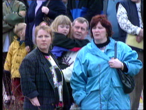 Two ten year olds in court ITN ENGLAND Liverpool S Sefton Magistrates Court People queuing outside court PAN LR MS Women as waiting in queue MS...