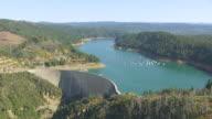 WS AERIAL POV Bullards bar reservoir and new bullards bar dam, Boats moored in reservoir, California