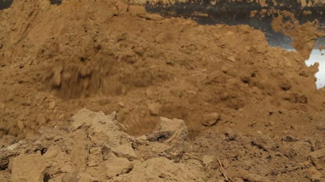Bulldozer Blade Pushing Dirt