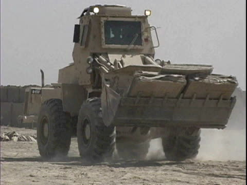 Bulldozer driving through construction site at Patrol Base Hawkes / Arab Jabour Iraq / AUDIO