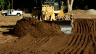 Bulldozer Moving Earth Towards Viewer