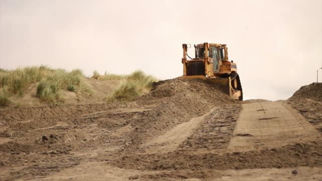 Bulldozer Pushing Sand