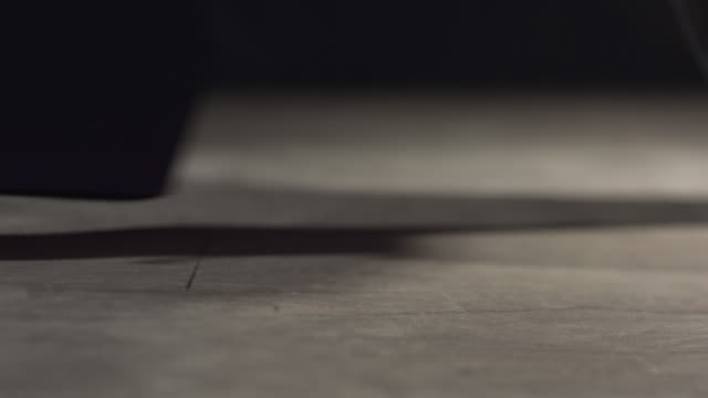 SLO MO Bullet casings falling to floor / Chicago, Illinois, United States
