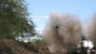 CU SLO MO bullet flying out of Muzzle Brake on M18 Hellcat tank firing / Peoria, Arizona, United States