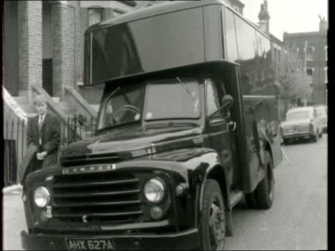 £750 thousand worth of bullion hijacked ***ALSO ENGLAND London Kentish Town BV Van with rear roller shutter closed FV Van PC in b/g CS Sign 'Twisden...