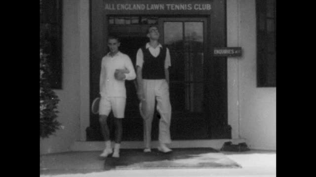 HW Bunny Austin with IH Laddie Wheatcroft at the entrance of the all England Lawn Tennis and Croquet Club in Wimbledon South East London circa 1935