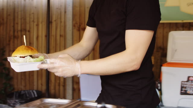 Burger Chef Serving Customer