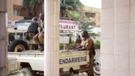 Burkina Faso security forces secure the area around the scene of a gunmen attack on a restaurant in Ouagadougou Burkina Faso on August 14 2017 At...