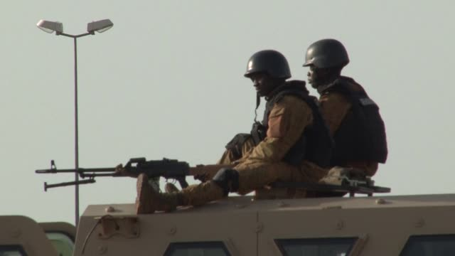 Burkina troops keep watch in the streets of Ouagadougou close to the barracks of the presidential guard the RSP which staged the coup on September 17
