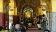 MS Burmese People pray in famous Mahamuni Pagoda / Mandalay, Mandalay Division, Myanmar