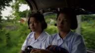 M/S Burmese teenage girls in the school bus
