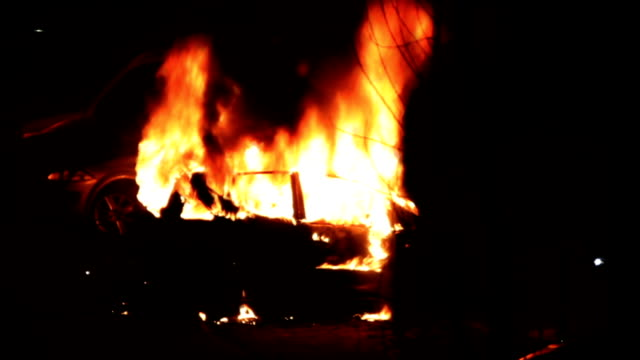 Burning car at night