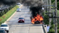 HD: Burning car on the road