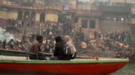 Burning Gaths with Funeral Pire and Bodies Waiting to be Splashed in the Ganges Men Taking Wood for the Pire Men and Mourner Bathing in the River