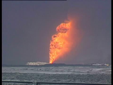 Burning oil well. Gulf War: Kuwait, 1991.